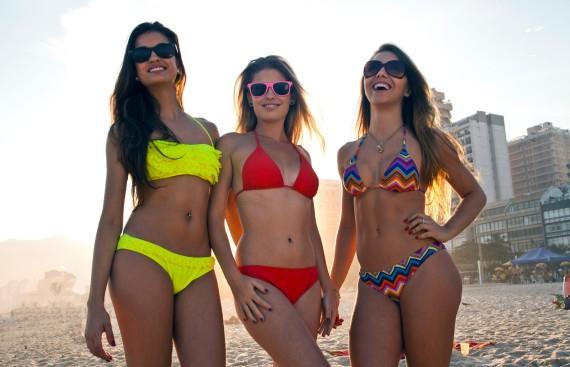 Three young women in bikinis on the beach in Rio, Brazil